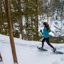 Woman snow shoeing Winter Park Colorado