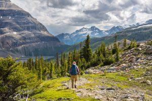 Man hiking through a mountain pass