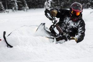 Man using snowmobile in powder snow